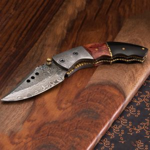 Damascus steel with rippled texture pattern on blade, one of best curved folding knife